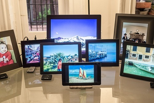 Different Digital Photo Frames On Table